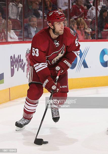 Derek Morris of the Phoenix Coyotes skates with the puck during the NHL game against the Edmonton Oilers at Jobingcom Arena on October 26 2013 in...