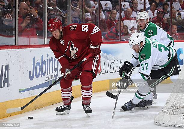 Derek Morris of the Phoenix Coyotes skates with the puck during the NHL game against the Dallas Stars at Jobing.com Arena on April 13, 2014 in...