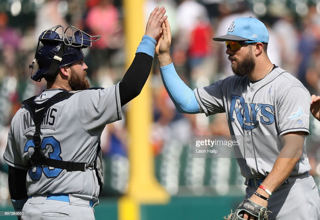 Derek Norris #33 and Colby Rasmus #28 of the Tampa Bay Rays celebrate a win over the Detroit Tigers on June 18, 2017 at Comerica Park in Detroit, Michigan. Tampa Bay defeated Detroit 9-1.