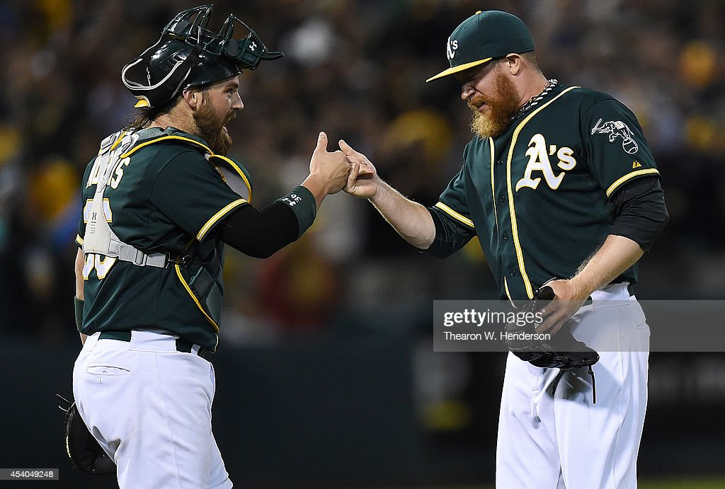 Derek Norris #36 and Sean Doolittle #62 of the Oakland Athletics celebrate after defeating the Los Angeles Angels of Anaheim 2-1 at O.co Coliseum on August 23, 2014 in Oakland, California.
