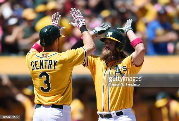 Derek Norris of the Oakland Athletics is congratulated by Craig Gentry after Norris hit a threerun homer in the bottom of the second inning against...