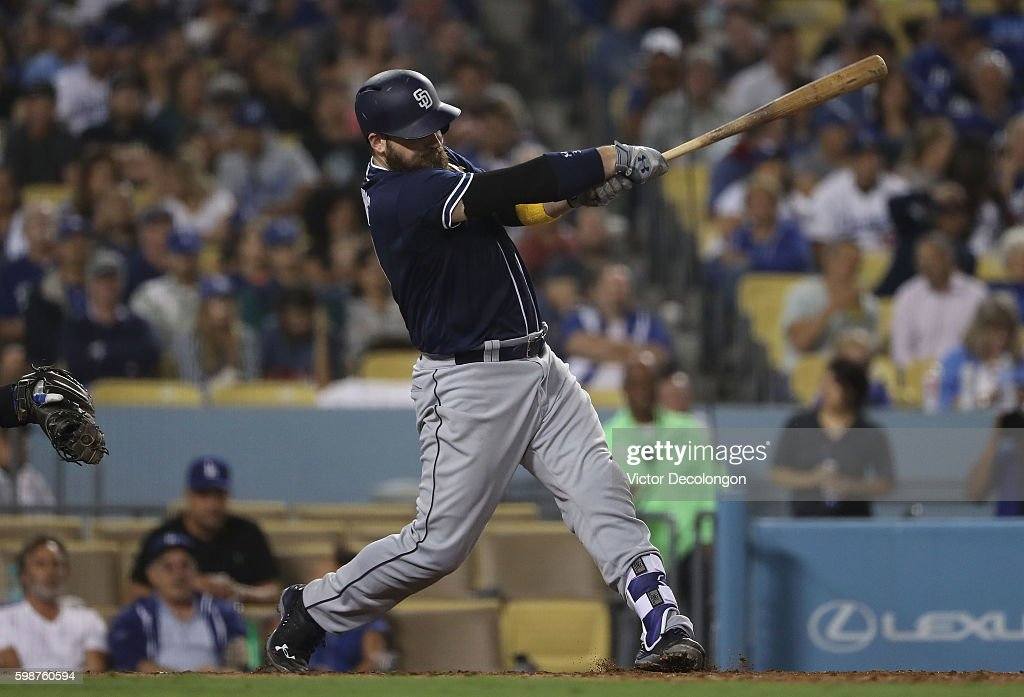 Derek Norris #3 of the San Diego Padres hits a two-run double during the sixth inning of their MLB game against the Los Angeles Dodgers at Dodger Stadium on September 2, 2016 in Los Angeles, California.