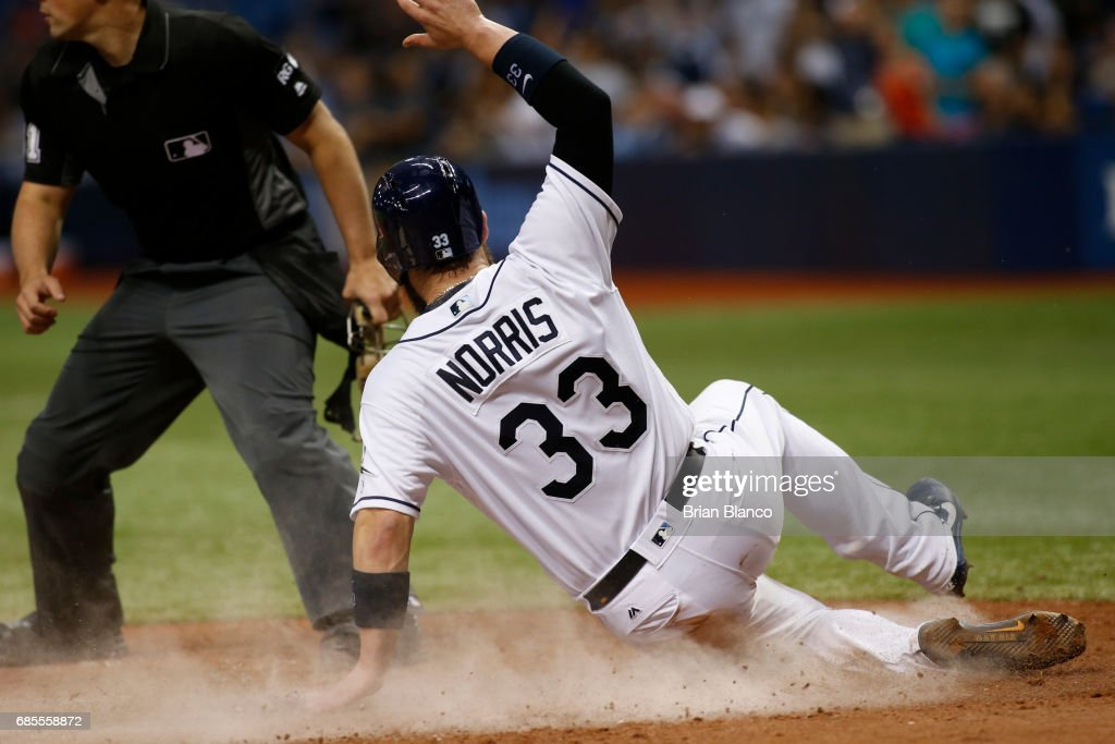 Derek Norris #33 of the Tampa Bay Rays slides home to score off of an RBI single by Evan Longoria during the eighth inning of a game against the New York Yankees on May 19, 2017 at Tropicana Field in St. Petersburg, Florida.