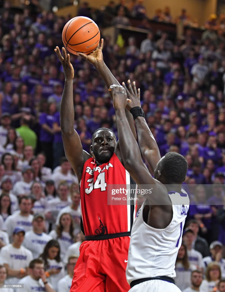 Derek Ogbeide #34 of the Georgia Bulldogs shoots the ball against Makol Mawien #14 of the Kansas State Wildcats during the first half on January 27, 2018 at Bramlage Coliseum in Manhattan, Kansas.