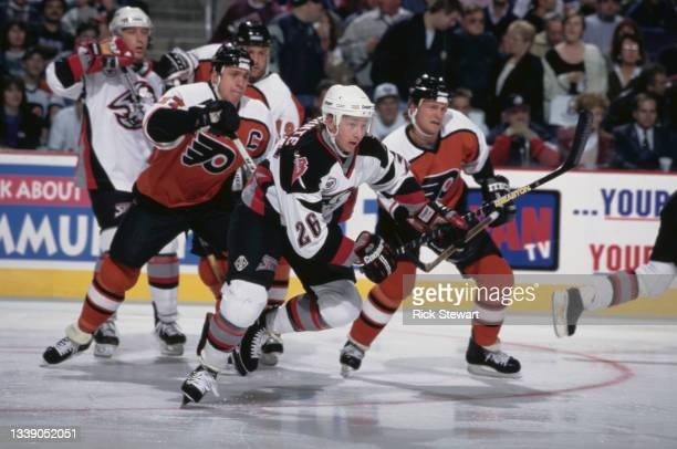 Derek Plante, Center for the Buffalo Sabres and Rod Brind'Amour of the Philadelphia Flyers in motion on the ice during their NHL Eastern Conference...