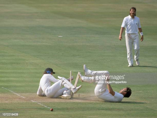 Derek Pringle of England collides with Australian batsman Dean Jones while attempting to field the ball off his own bowling as Ian Botham looks on...