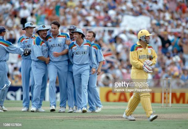 Derek Pringle of England is congratulated by teammates after taking the wicket of Australia's Mark Taylor LBW for 0 during the Benson and Hedges...