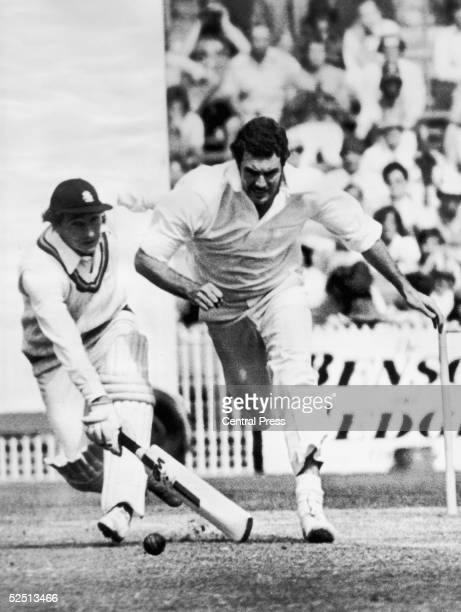 Derek Randall of the MCC clashes with Australian fielder Greg Chapell going for the ball during the centenary test match against Australia in...