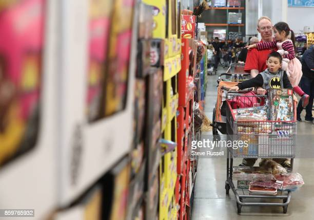 Derek Rayside and his wife Stephanie Xie shop at the Costco in south Etobicoke with their kids and then ride home on Queens Quay