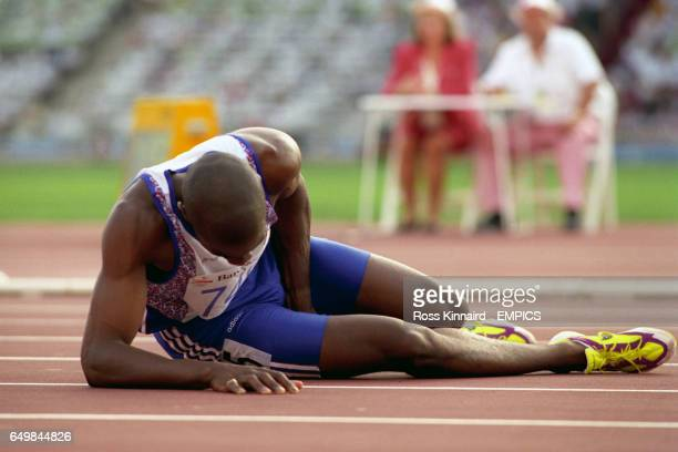 Derek Redmond in agony after suffering injury during the Mens 400m race DEREK REDMOND LIES ON THE FLOOR IN AGONY AFTER AN INJURY IN THE 400M