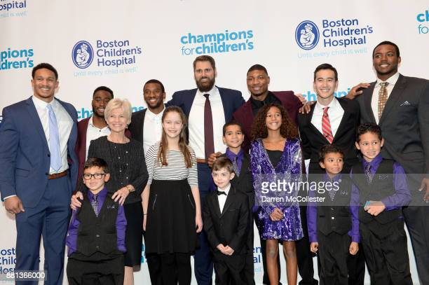 Derek Rivers Brandin Cooks Malcolm Mitchell Sebastian Vollmer Marcus Smart Justin Doo and Adam Butler with the kids at Champions for Children's...