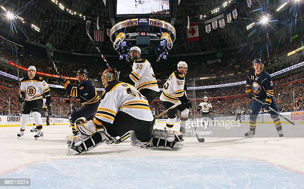 Derek Roy and Tim Kennedy of the Buffalo Sabres keep an eye on the puck along with Tuukka Rask Zdeno Chara Shawn Thornton and Johnny Boychuk of the...