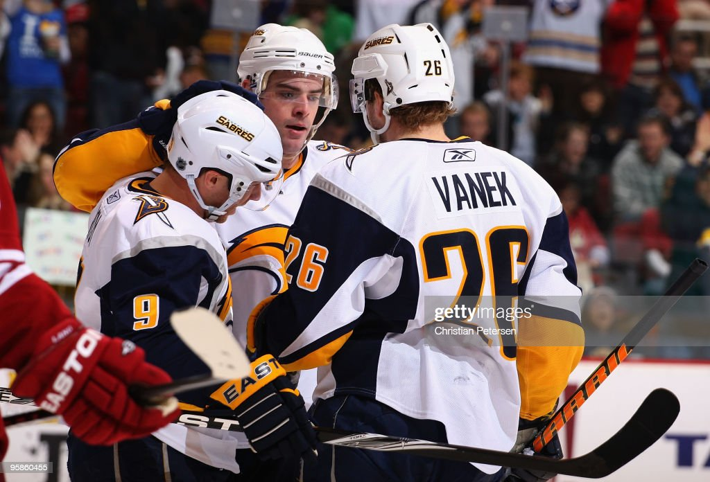 Derek Roy #9, Drew Stafford #21 and Thomas Vanek #26 of the Buffalo Sabres celebrate after Vanek scored a third period goal against the Phoenix Coyotes during the NHL game at Jobing.com Arena on January 18, 2010 in Glendale, Arizona. The Sabres defeated the Coyotes 7-2.