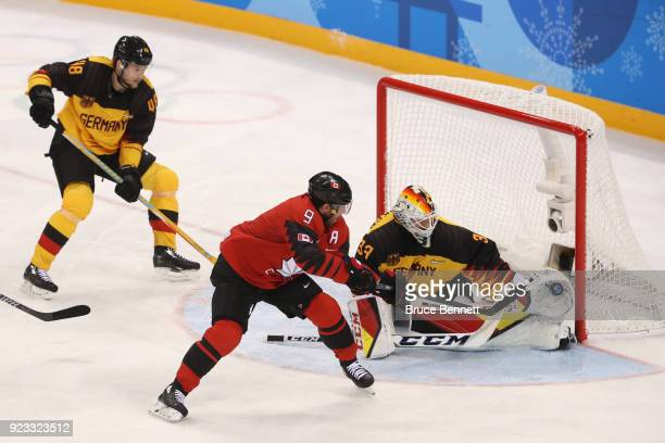 Derek Roy of Canada shoots against Danny Aus Den Birken of Germany in the first period during the Men's Playoffs Semifinals on day fourteen of the...