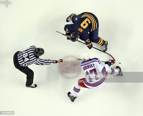 Derek Roy of the Buffalo Sabres and Brandon Dubinsky of the New York Rangers take a faceoff with linesman Tony Sericolo on January 9 2009 at HSBC...