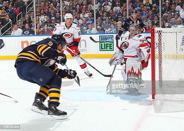 Derek Roy of the Buffalo Sabres scores a first period goal against the Cam Ward of the Carolina Hurricanes at First Niagara Center on October 14 2011...