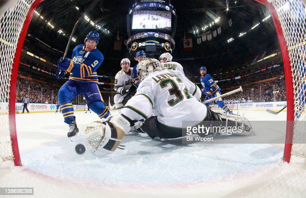 Derek Roy of the Buffalo Sabres scores the game tying goal late in the third periodl against Kari Lehtonen of the Dallas Stars at First Niagara...