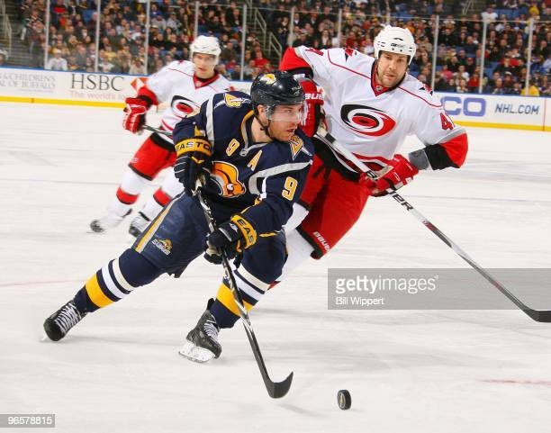 Derek Roy of the Buffalo Sabres skates around Andrew Alberts of the Carolina Hurricanes on February 5, 2010 at HSBC Arena in Buffalo, New York. The...