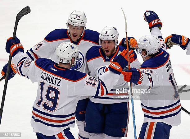 Derek Roy of the Edmonton Oilers celebrates his first period goal with teammates Justin Schultz Oscar Klefbom and Nail Yakupov against the Chicago...