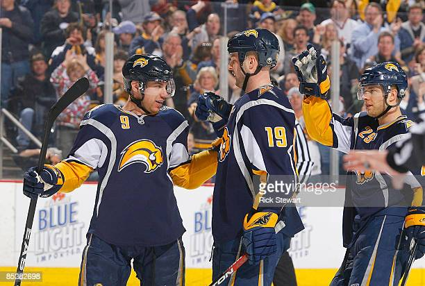 Derek Roy Tim Connolly and Jason Pominville of the Buffalo Sabres celebrate Connolly's goal in the second period against the Phoenix Coyotes on March...