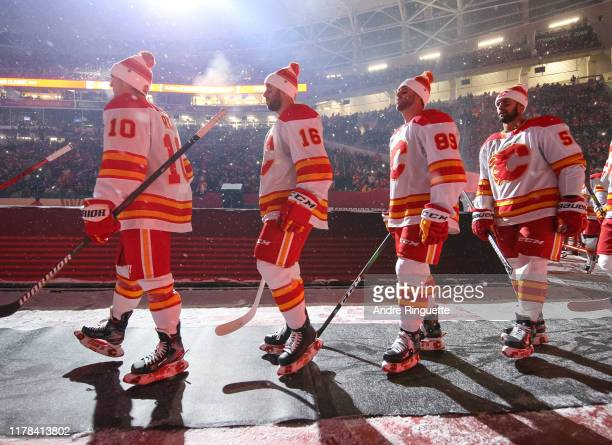 Derek Ryan and Tobias Rieder of the Calgary Flames walk to the ice before taking on the Winnipeg Jets during the 2019 Tim Hortons NHL Heritage...