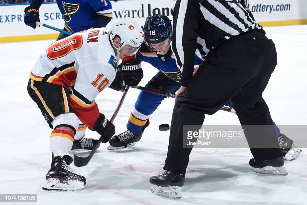 Derek Ryan of the Calgary Flames faces off against Robert Thomas of the St Louis Blues at Enterprise Center on December 16 2018 in St Louis Missouri