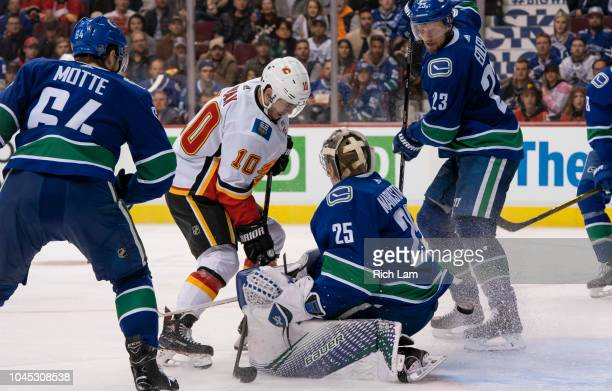 Derek Ryan of the Calgary Flames is stopped by Jacob Markstrom of the Vancouver Canucks in close in NHL action on October 2018 at Rogers Arena in...