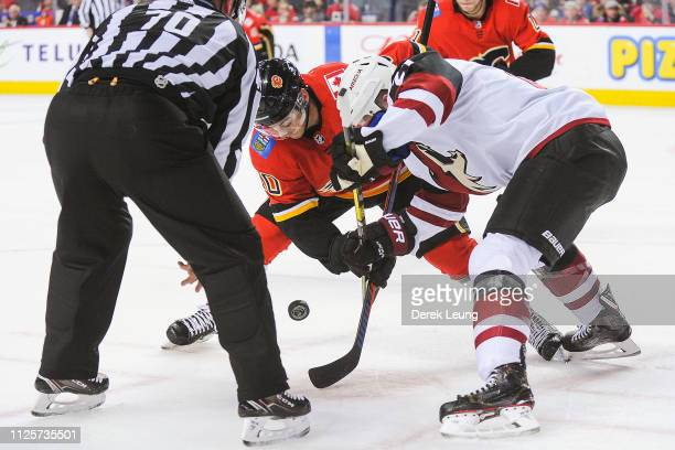 Derek Ryan of the Calgary Flames takes the faceoff against of the Arizona Coyotes during an NHL game at Scotiabank Saddledome on February 18 2019 in...
