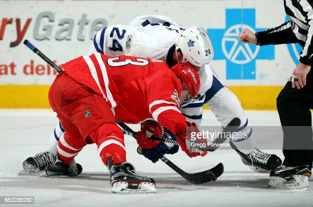 Derek Ryan of the Carolina Hurricanes and Brian Boyle of the Toronto Maple Leafs battle for the puck on a faceoff during an NHL game on March 11 2017...