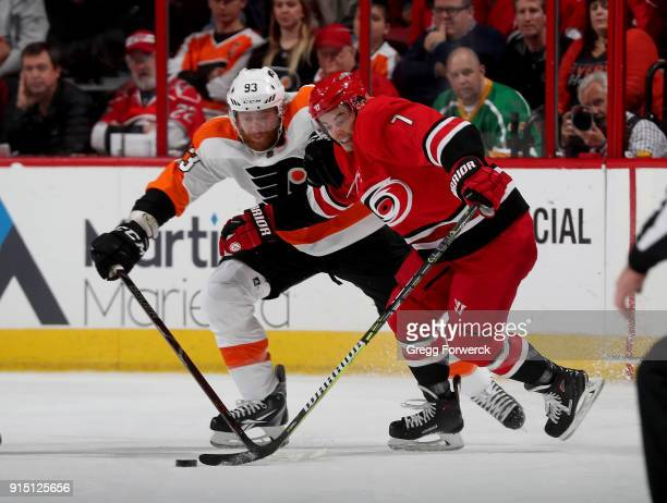 Derek Ryan of the Carolina Hurricanes and Jakub Voracek of the Philadelphia Flyers battle for the loose puck during an NHL game on February 6 2018 at...