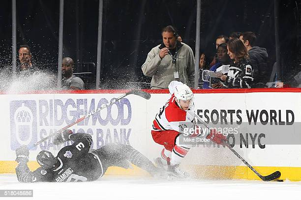 Derek Ryan of the Carolina Hurricanes checks Travis Hamonic of the New York Islanders at the Barclays Center on March 29 2016 in Brooklyn borough of...