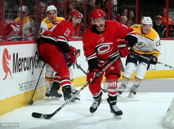 Derek Ryan of the Carolina Hurricanes circles the net as members of the Nashville Predators look on during an NHL game on November 26 2017 at PNC...