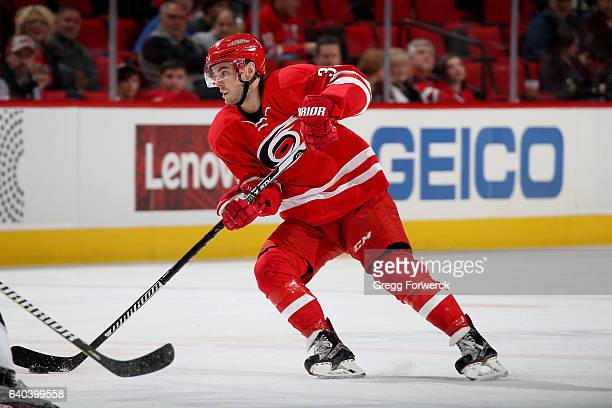 Derek Ryan of the Carolina Hurricanes controls the puck on the ice during an NHL game against the Los Angeles Kings on January 26 2017 at PNC Arena...
