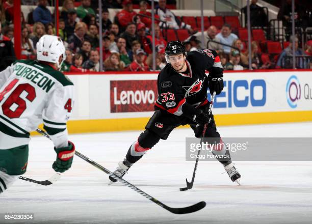 Derek Ryan of the Carolina Hurricanes controls the puck on the ice during an NHL game against the Minnesota Wild on March 16 2017 at PNC Arena in...