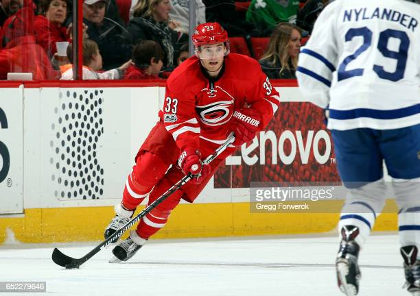Derek Ryan of the Carolina Hurricanes crosses into the neutral zone with the puck during an NHL game against the Toronto Maple Leafs on March 11 2017...