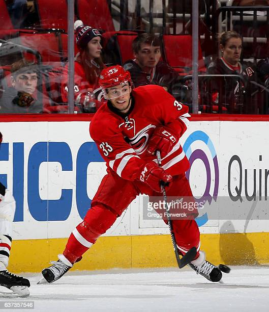 Derek Ryan of the Carolina Hurricanes passes the puck during an NHL game against the Chicago Blackhawks on December 30 2016 at PNC Arena in Raleigh...