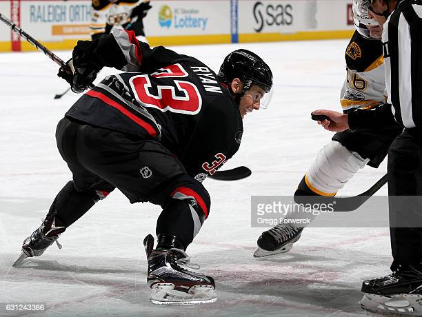 Derek Ryan of the Carolina Hurricanes prepares for a faceoff during an NHL game against the Boston Bruins on January 8 2017 at PNC Arena in Raleigh...