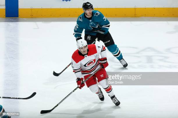 Derek Ryan of the Carolina Hurricanes skates ahead of Jannik Hansen of the San Jose Sharks at SAP Center on December 7 2017 in San Jose California