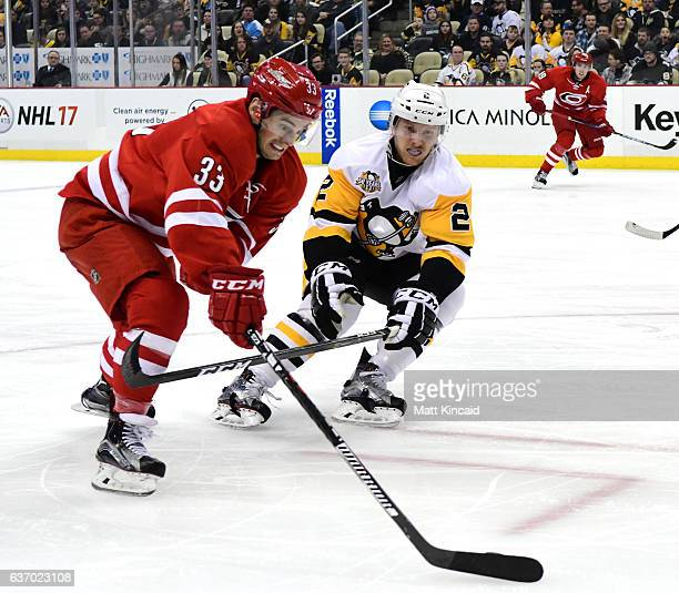 Derek Ryan of the Carolina Hurricanes skates with the puck against Chad Ruhwedel of the Pittsburgh Penguins at PPG PAINTS Arena on December 28 2016...
