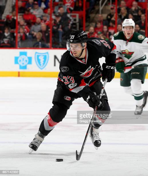 Derek Ryan of the Carolina Hurricanes skates with the puck during an NHL game against the Minnesota Wild on March 16 2017 at PNC Arena in Raleigh...