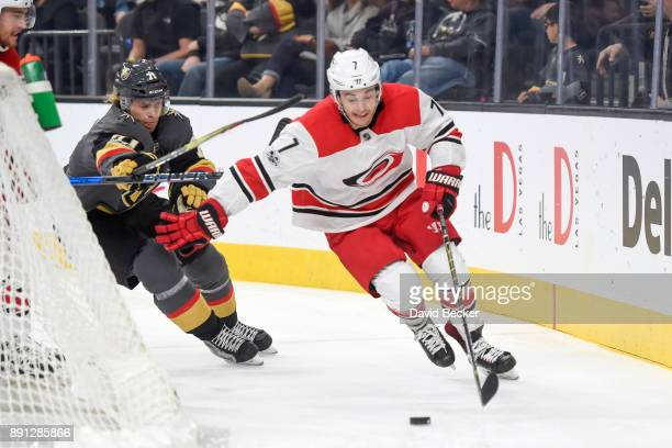 Derek Ryan of the Carolina Hurricanes skates with the puck while William Karlsson of the Vegas Golden Knights defends during the game at TMobile...