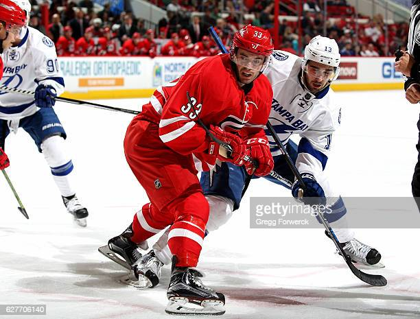 Derek Ryan of the Carolina Hurricanes wins a faceoff against Cedric Paquette of the Tampa Bay Lightning during an NHL game on December 4 2016 at PNC...