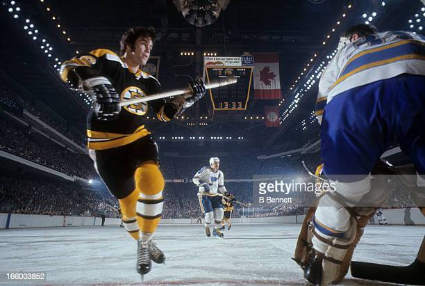 Derek Sanderson of the Boston Bruins skates on the ice during an NHL game against the St. Louis Blues circa 1967 at the Boston Garden in Boston,...