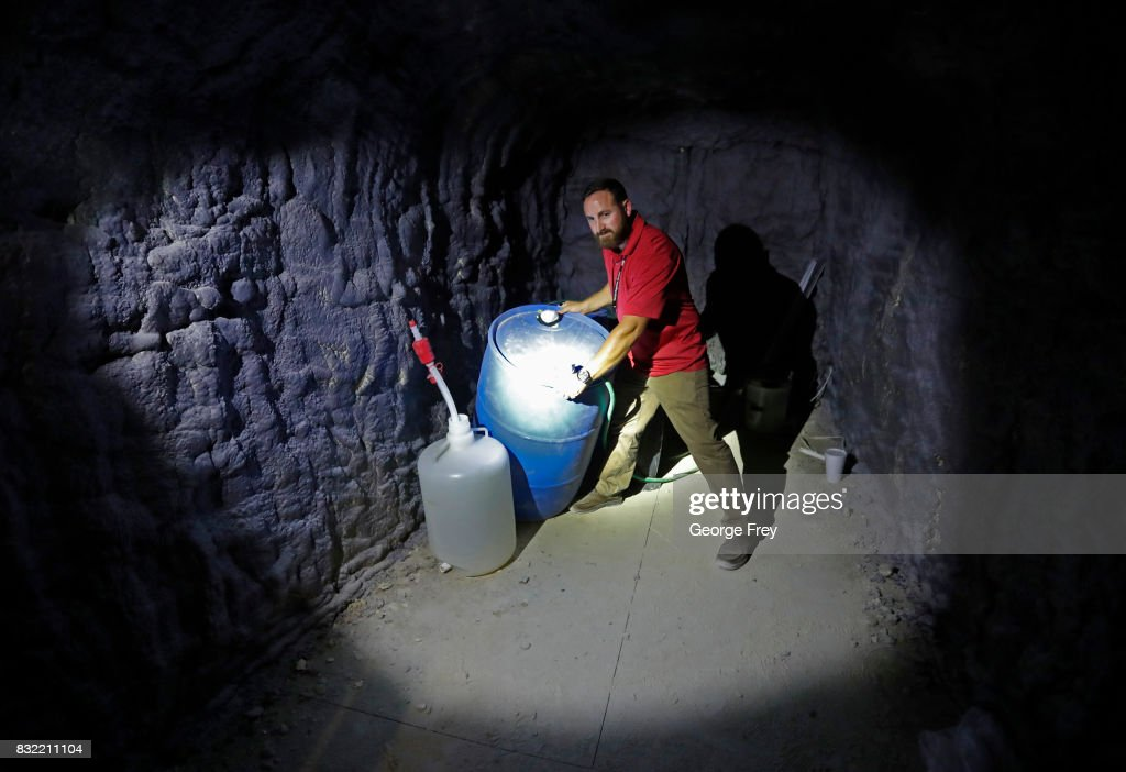 Derek Schumann of Jacobs Engineering Group sets up a chemical training scenario inside the newly created BRAUCH training facility at the U.S. Army's v Proving Ground on August 15, 2017 in Dugway, Utah. The BRAUCH facility is made up of old shipping containers that are hooked together to simulate an underground environment such as caves and tunnel complexes, so military units such as special forces can train for those environments.