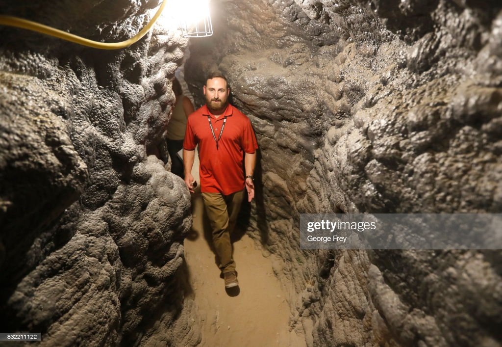 Derek Schumann of Jacobs Engineering Group walks through a narrow section of the newly created BRAUCH training facility at the U.S. Army's Dugway Proving Ground on August 15, 2017 in Dugway, Utah. The BRAUCH facility is made up of old shipping containers that are hooked together to simulate an underground environment such as caves and tunnel complexes, so military units such as special forces can train for those environments.
