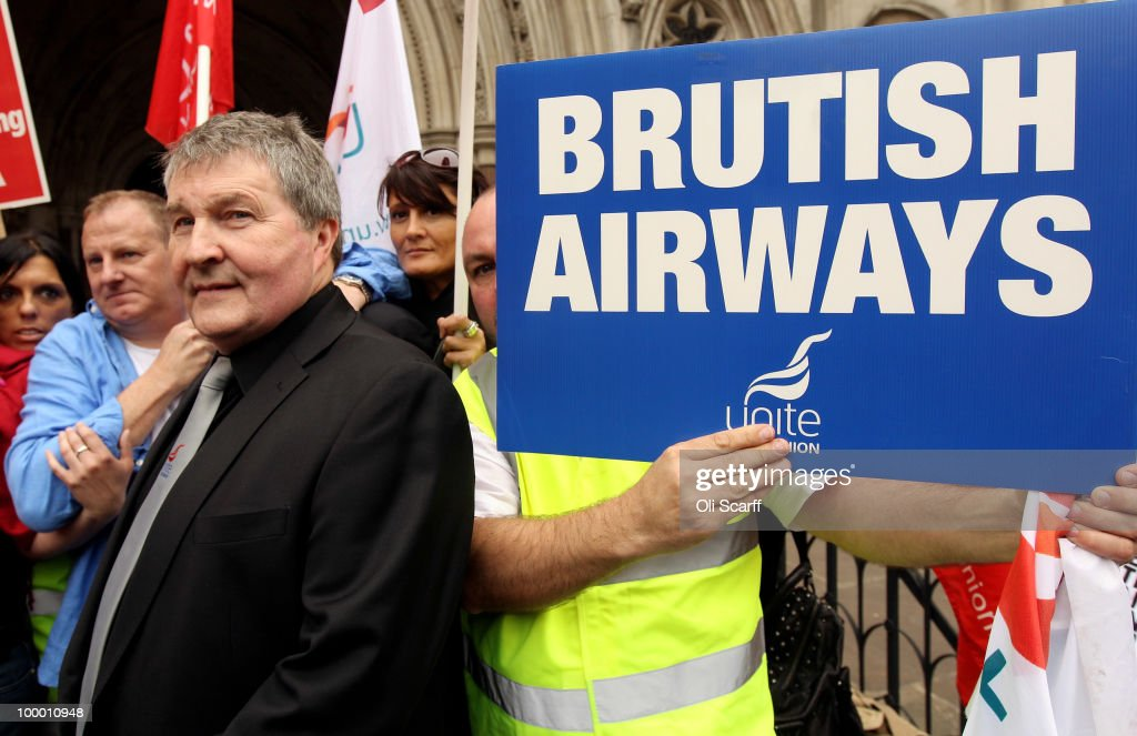 Derek Simpson (third left), the Joint General Secretary of the Unite union, poses with BA cabin crew outside the High Court after the court overturned a ban on strike action by BA cabin crew on May 20, 2010 in London, England. The High Court had previously granted British Airways an injunction against industrial action by cabin crew over failings by the Unite union in their reporting of the results of its strike ballot to members.