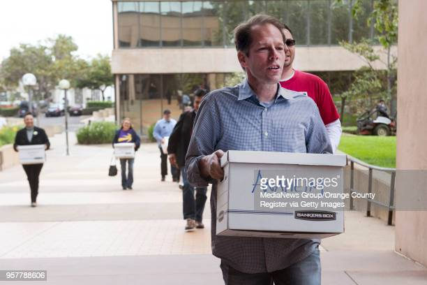 Derek Smith with Unite Here Local 11 helps deliver some of the 22000 signatures on petitions to qualify an initiative for the November 2018 ballot...