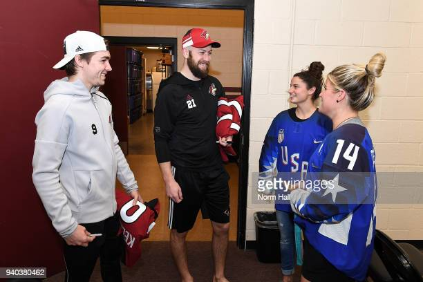 Derek Stepan and Clayton Keller of the Arizona Coyotes take a picture with Brianna Decker and Amanda Pelkey members of the 2018 United States Women's...