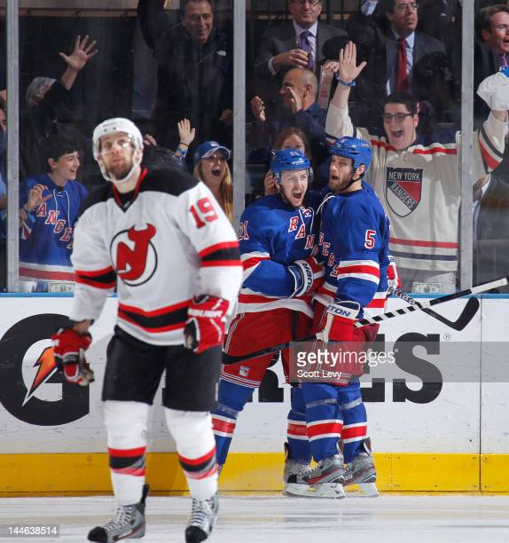 Derek Stepan and Dan Girardi of the New York Rangers celebrate a second period goal against the New Jersey Devils in Game Two of the Eastern...