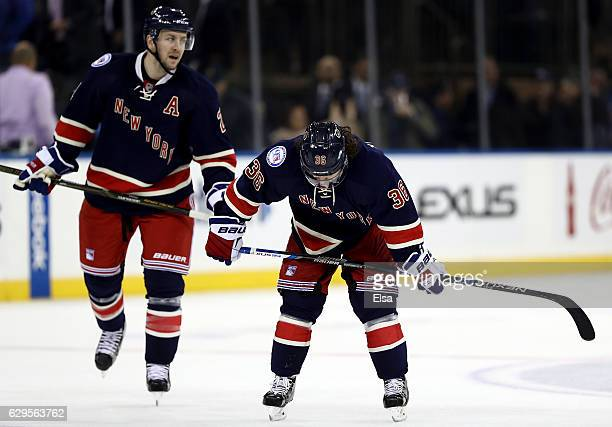 Derek Stepan and Mats Zuccarello of the New York Rangers reacts to the loss to the Chicago Blackhawks on December 13 2016 at Madison Square Garden in...